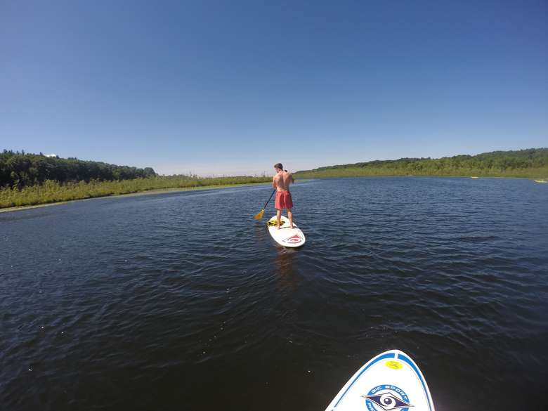 Man in red shorts on paddleboard